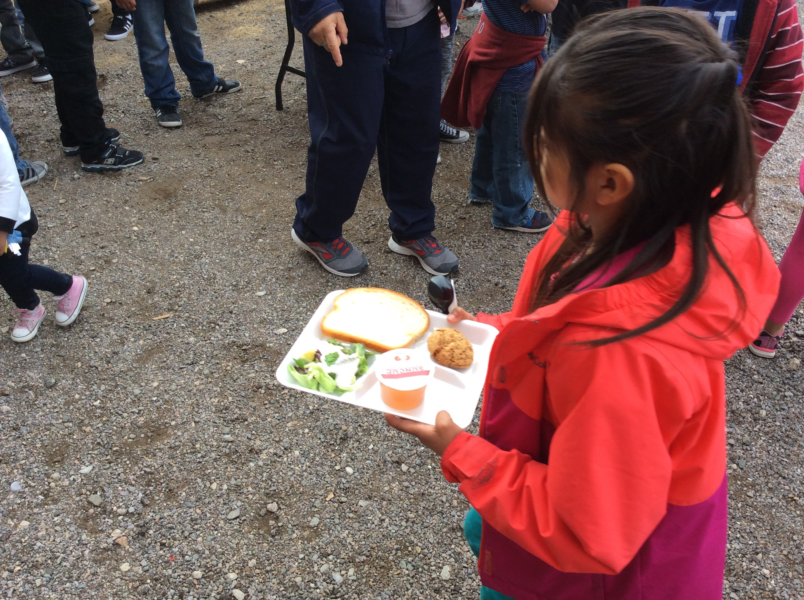 Student with her stone soup in hands.